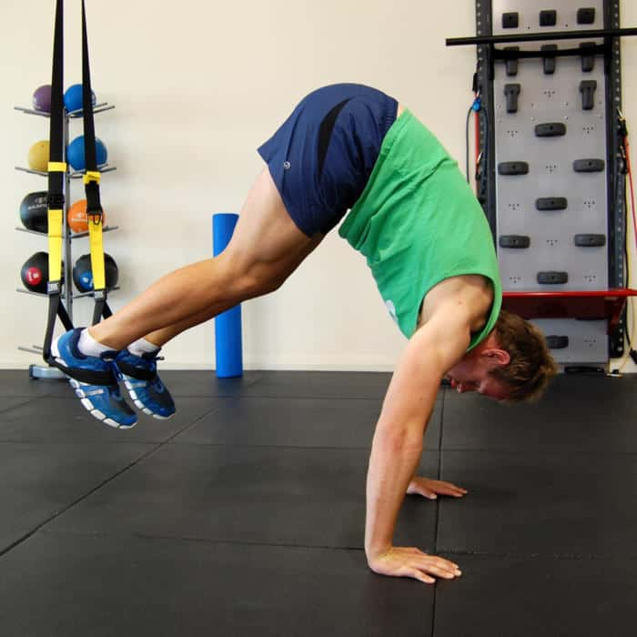 Man performing the TRX Pike