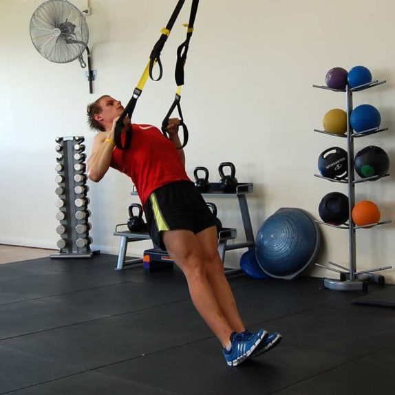 Man performing TRX Squat Row