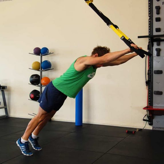 Man performing a TRX superman